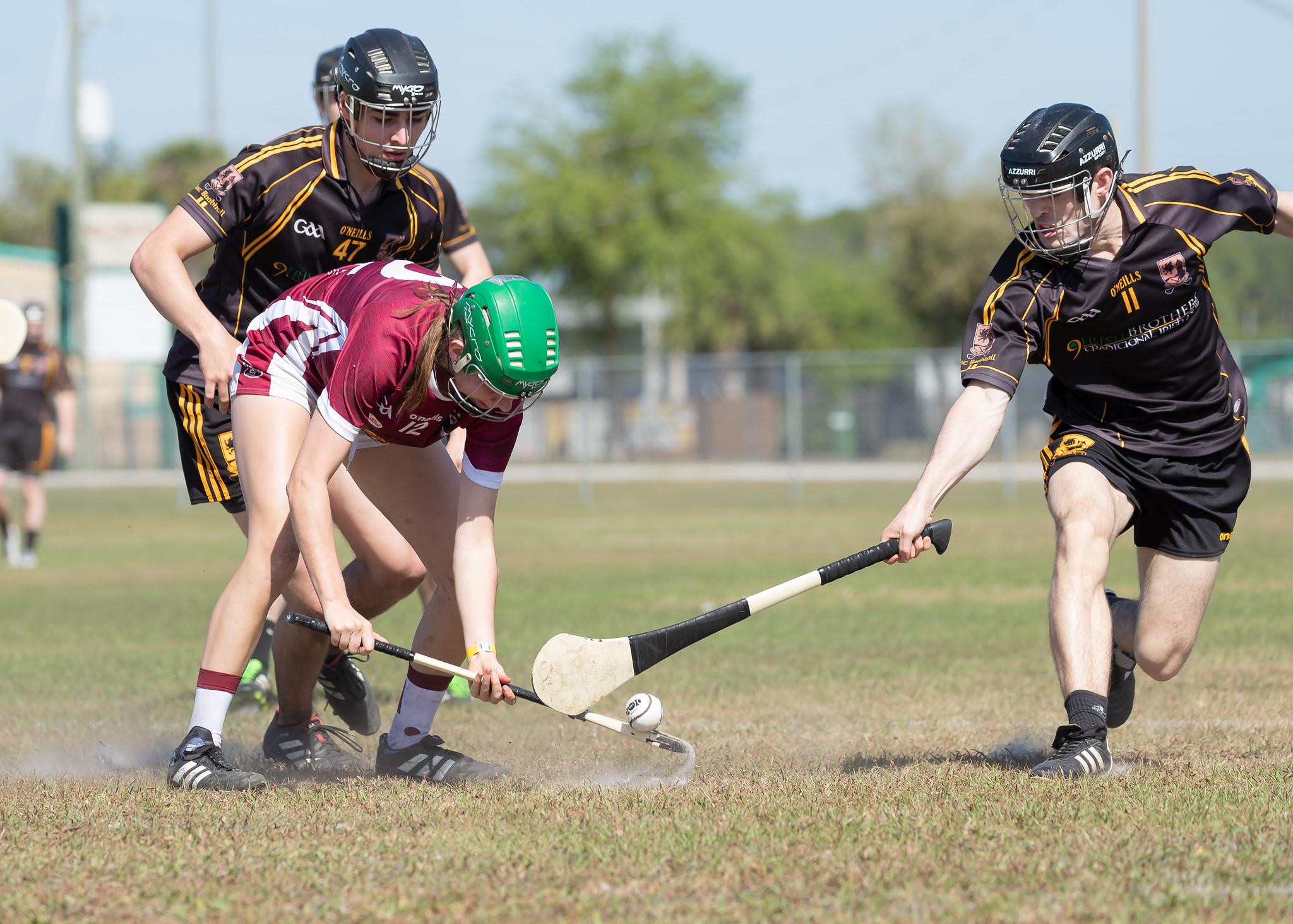 An Irishmen flicks it away from the opponents